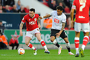 Bristol City forward Lee Tomlin and Derby County defender Cyrus Christie during the Sky Bet Championship match between Bristol City and Derby County at Ashton Gate, Bristol, England on 19 April 2016. Photo by Graham Hunt.