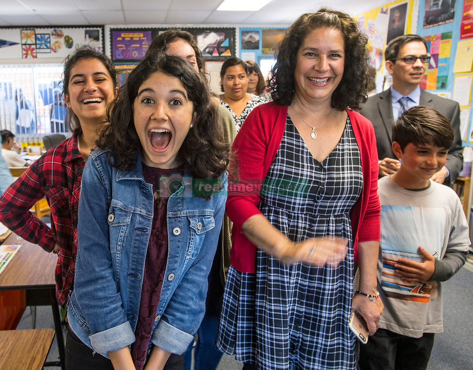 May 2, 2017 - Huntington Beach, California, USA - Gianvittoria (cq) Saporito, left, and her mother, Dorene Saporito, right, join other family members as they react while their father/husband, Vincent Saporito is surprised with a 2018 Teacher of the Year award from the Orange County Department of Education in Huntington Beach, California, on Tuesday, May 2, 2017. ..Saporito, is a special education teacher for the deaf and hard of hearing at College View Elementary School, is one of six teachers who were surprised with the honor by county superintendent of school Dr. Al Mija?res. ..(Photo by Jeff Gritchen, Orange County Register/SCNG) (Credit Image: © Jeff Gritchen, Jeff Gritchen/The Orange County Register via ZUMA Wire)