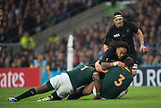 Twickenham. Great Britain,  NZ's Ma'a NONU, taken down by left Tendai MTAWARIRA and Frans MALHERBE during, Semi Final 1. South Africa vs New Zealand  2015 Rugby World Cup,  Venue, Twickenham Stadium, Surrey England.   Saturday  24/10/2015.   [Mandatory Credit; Peter Spurrier/Intersport-images]