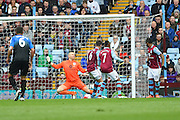 Aston Villa goalkeeper Brad Guzan (1) fails to save the ball from Bournemouth defender Steve Cook (3) during the Barclays Premier League match between Aston Villa and Bournemouth at Villa Park, Birmingham, England on 9 April 2016. Photo by Jon Hobley.