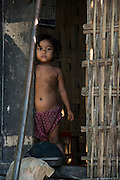 Mising child at home<br /> Mising Tribe (Mishing or Miri Tribe)<br /> Majuli Island, Brahmaputra River<br /> Largest river island in India<br /> Assam,  ne India