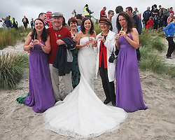 'Fainne Geal an Lae'.Carol O'Malley, John 'Twin' McNamara, Threasa O'Malley (mother of bride),.Aoife Galvin, who was married on friday the 30th alongside Mary McNamara and bridesmade Fionulla Lovelock  pictured on Keel beach Achill where the Tin Whistle world record attempt took place on saturday last..Pic Conor McKeown