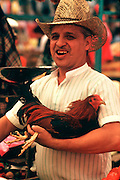 MEXICO, MARKETS Xochimilco; man with chicken