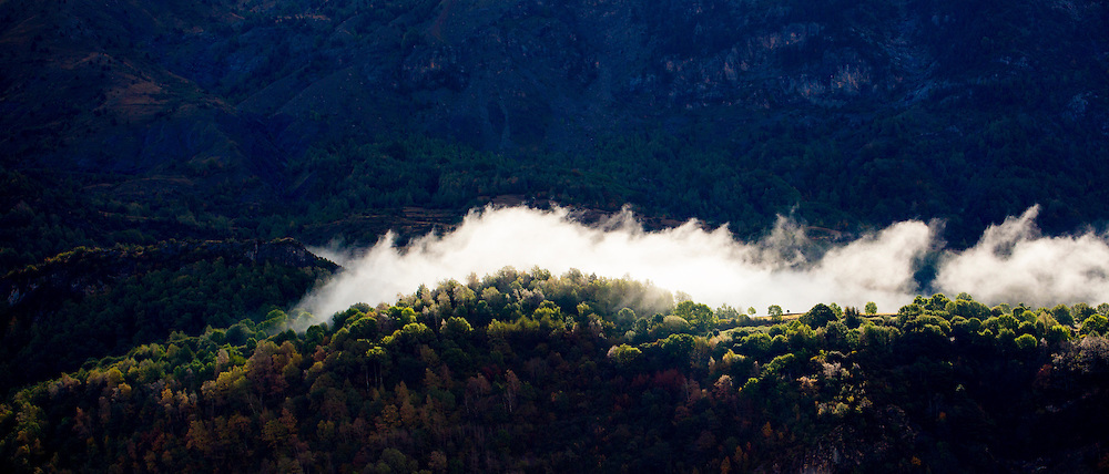 Clouds drifting through mountain valley landscape of Valle de Tena in the Pyrenees in Aragon, Northern Spain