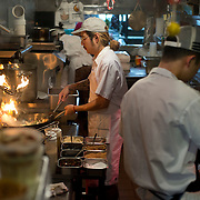 Chef Danny Bowien, left, works in the kitchen of his restaurant, Mission Chinese, at its New York City location on the Lower East Side of Manhattan on Tuesday, July 31, 2012 in New York, NY...