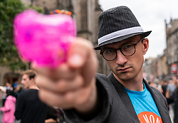Edinburgh, Scotland, UK; 5 August, 2018. Edinburgh Fringe Festival's first weekend sees thousands of tourists and locals on the Royal Mile  enjoying the free street performers. Pictured; Actor promoting show, Big Trouble in Little Monkey's Daycare