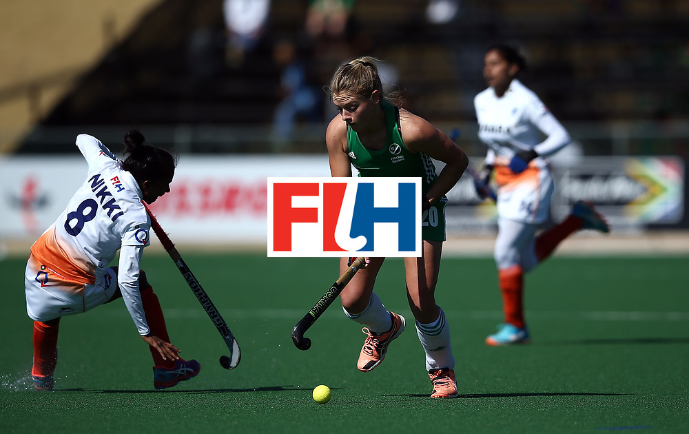 JOHANNESBURG, SOUTH AFRICA - JULY 22:  Chloe Watkins of Ireland battles with Nikki Pradhan of India during day 8 of the FIH Hockey World League Women's Semi Finals 7th/ 8th place match between India and Ireland at Wits University on July 22, 2017 in Johannesburg, South Africa.  (Photo by Jan Kruger/Getty Images for FIH)