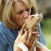 Melinda Clark Ruth give Bo Duke, one of her puppies, a kiss.