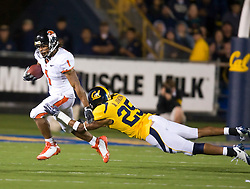 November 7, 2009; Berkeley, CA, USA;  Oregon State Beavers running back Jacquizz Rodgers (1) avoids a diving tackle from California Golden Bears cornerback Brett Johnson (25) during the third quarter at Memorial Stadium.