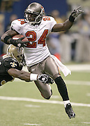 NEW ORLEANS - OCTOBER 10:  Torrie Cox #24 of the Tampa Bay Buccaneers returns a kick for a short gain against the New Orleans Saints at the Louisiana Superdome on October 10, 2004 in New Orleans, Louisiana. The Bucs defeated the Saints 20-17. ©Paul Anthony Spinelli *** Local Caption *** Torrie Cox