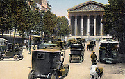 Paris c1900. Rue Royale and the Madeleine, with cars and motorbus Tinted lithograph