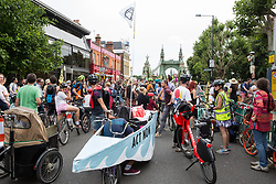 London, UK. 17 July, 2019. Climate activists from Extinction Rebellion pause on Hammersmith bridge during a Critical Mass bicycle ride from their camp on Waterloo Millennium Green to Hammersmith Town Hall on the third day of their 'Summer uprising'. The activists have three demands for Hammersmith and Fulham Council: to pass the proposed motion to declare a Climate Emergency; to keep Hammersmith bridge closed to vehicles; and to commit to safer cycling routes.