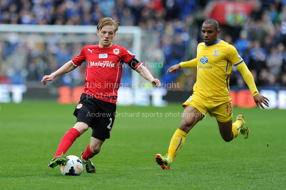Mats Daehli of Cardiff city gets away from Jason Puncheon of Crystal Palace (r). Barclays Premier league match, Cardiff city v Crystal Palace at the Cardiff city stadium in Cardiff, South Wales on Saturday 5th April 2014.<br /> pic by Andrew Orchard, Andrew Orchard sports photography.