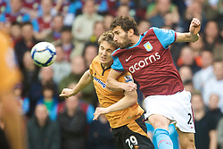 WOLVERHAMPTON, ENGLAND - Saturday, October 24, 2009: Aston Villa's Carlos Jimenez Cuellar and Wolverhampton Wanderers' Kevin Doyle during the Premiership match at Molineux. (Photo by David Rawcliffe/Propaganda)
