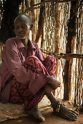 Dadaab, Kenya -   2014-08-16 - Abdi Farah, 30, witnessed his father being shot in the head in Somalia. After years of untreated psychological trauma he is mentally unstable and is kept chained in his hut in the Hagadera camp in Dadaab, Kenya on August 16, 2014. His father, Farah Hayd Ali, survived the shooting partially paralyzed and is now the chairman of a local group of disabled persons. - Photo by Daniel Hayduk