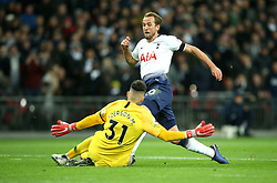Tottenham Hotspur's Harry Kane (right) is tackled by Manchester City goalkeeper Ederson