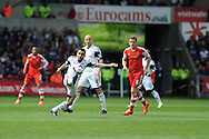 Swansea city's Leon Britton controls the ball. Barclays Premier league match, Swansea city v Southampton at the Liberty stadium in Swansea, South Wales on Saturday 3rd May 2014.<br /> pic by Andrew Orchard, Andrew Orchard sports photography.