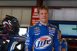 June 25, 2011; Sonoma, CA, USA;  NASCAR Sprint Cup Series driver Brad Keselowski (2) stands next to his car in the garage during practice for the Toyota/Save Mart 350 at Infineon Raceway.