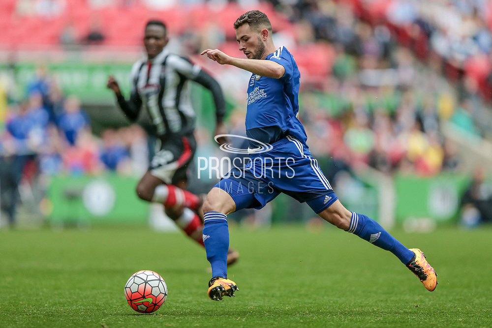 Connor Hughes (Halifax) runs with the ball during the FA Trophy match between Grimsby Town FC and Halifax Town at Wembley Stadium, London, England on 22 May 2016. Photo by Mark P Doherty.