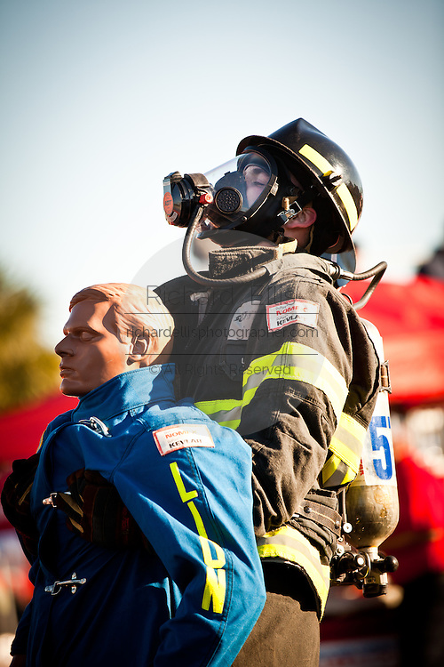 A firefighter drags a 175-pound mannequin backwards wearing full firefighting gear and working against the clock during the international finals of the Firefighter Combat Challenge on November 18, 2011 in Myrtle Beach, South Carolina.
