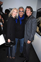 TAMARA VERONI and FLAVIO BRIATORE and TIM JEFFERIES at a private view of Octagan a showcase of work of photographer Kevin Lynch featuring the stars of the Ultimate Fighter Championship held at Hamiltons gallery, Mayfair, London on 17th January 2008.<br />