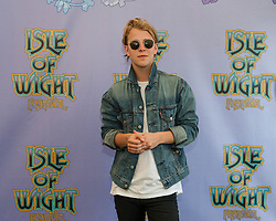 © Licensed to London News Pictures. 13/06/2014. Isle of Wight, UK. Singer Songwriter Tom Odell at a photocell at the Isle of Wight Festival 2014.The Isle of Wight festival is an annual music festival that takes place on the Isle of Wight. Photo credit : Richard Isaac/LNP