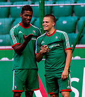 29/07/14<br /> LEGIA WARSAW TRAINING<br /> PEPSI ARENA - WARSAW<br /> Legia Warsaw ace and former Motherwell man Henrik Ojamaa (right) shares a joke with team mates