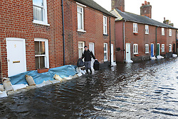 A resident rescues possessions from his  flooded home in the village of Bridge, Kent , United Kingdom. Sunday, 9th February 2014. Picture by Stephen Lock / i-Images