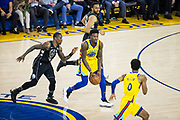 Golden State Warriors center Jordan Bell (2) passes the ball to Golden State Warriors guard Patrick McCaw (0) against the Milwaukee Bucks at Oracle Arena in Oakland, Calif., on March 29, 2018. (Stan Olszewski/Special to S.F. Examiner)