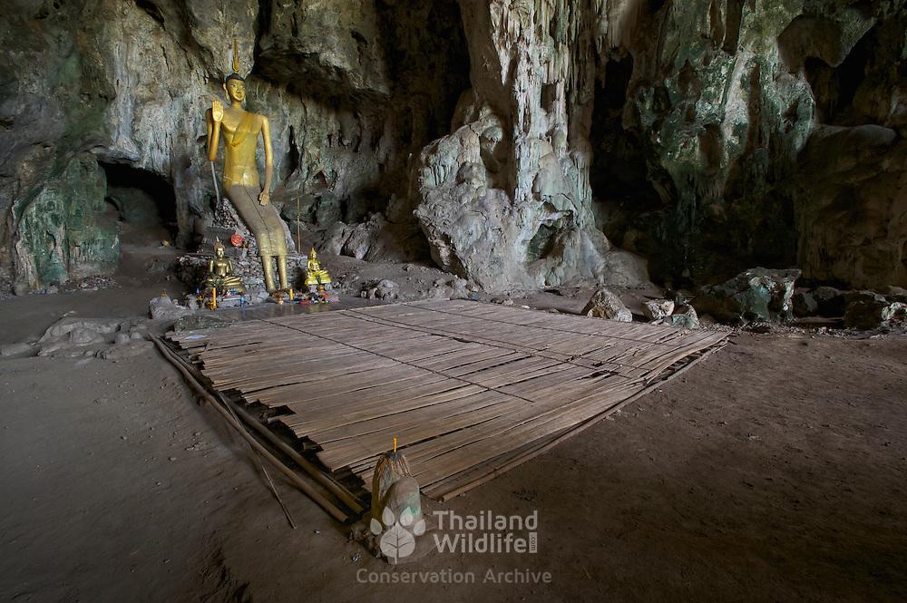 The main Buddha at Tham Phra Prang, a cave located in Khuean Srinagarindra National Park, Thailand.