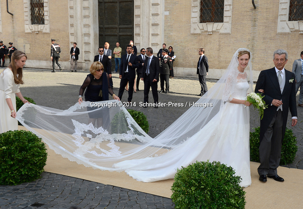 Image ©Licensed to i-Images Picture Agency. 05/07/2014. Rome, Italy. Elisabetta Maria Rosboch von Wolkenstein and her father Ettore Rosboch von Wolkenstein arrive for her wedding to Prince Amedeo of Belgium at Basilica Santa Maria in Trastevere. Picture by  Schneider-Press / i-Images<br /> UK&USA ONLY