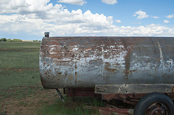 detail of a rusted and painted gas tan on a ranch in New Mexico