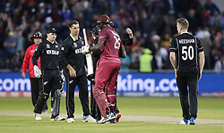 West Indies Carlos Brathwaite is consoled by the New Zealand team at the end of the ICC Cricket World Cup group stage match at Old Trafford, Manchester.