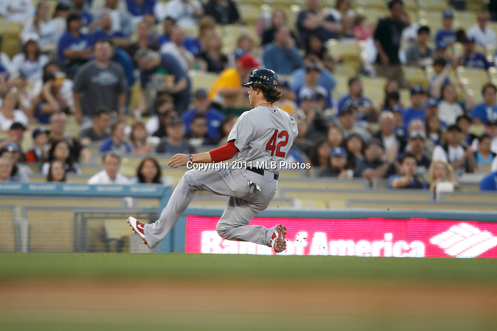 LOS ANGELES, CA - APRIL 15:  Colby Rasmus #28 of the St. Louis Cardinals slides into third base during the game between the St. Louis Cardinals and the Los Angeles Dodgers on Friday April 15, 2011 at Dodger Stadium in Los Angeles, California. (Photo by Paul Spinelli/MLB Photos via Getty Images) *** Local Caption *** Colby Rasmus