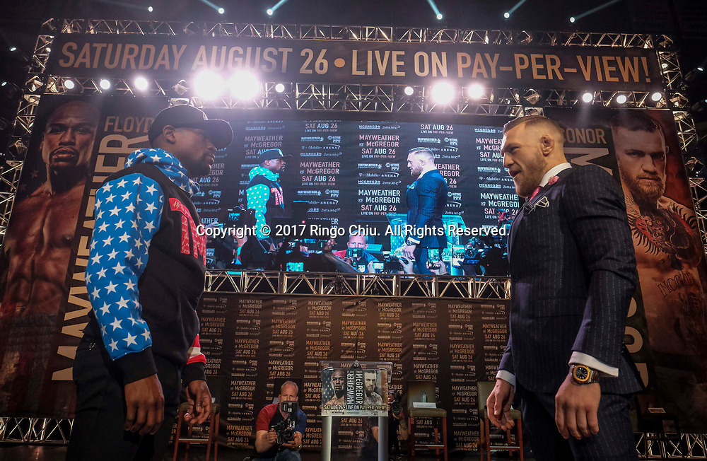 Floyd Mayweather Jr., and Conor McGregor in a news conference at Staples Center Tuesday, July 11, 2017.  (Photo by Ringo Chiu)<br /> (Photo by Ringo Chiu)<br /> <br /> Usage Notes: This content is intended for editorial use only. For other uses, additional clearances may be required.