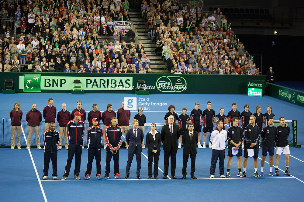Team GB line up with opponents USA for the Davis Cup World Group tie in Glasgow. Officials and ball-kids also present