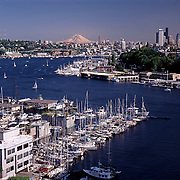 Mt. Rainier behind Seattle, Washington skyline with Lake Union, house boats and sailboat marina in foreground<br />