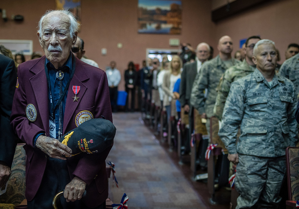 rer040517b/1/04.05.2017/Roberto E. Rosales <br /> Former prisoners of war from World War II, Korea and Vietnam along with their families were guests during ceremony for recognition on April 5 at the Raymond G. Murphy VA Medical Center.  Pictured WWII Vet Pedro Gonzalez(Cq) standing during the playing of TAPS during the ceremony. <br /> <br /> Albuquerque, New Mexico(Roberto E. Rosales/Albuquerque Journal)