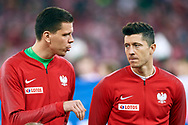 Chorzow, Poland - 2018 March 27: (L) goalkeeper Wojciech Szczesny from Poland talks with (R) Robert Lewandowski from Poland before Poland v South Korea International Friendly Soccer match at Stadion Slaski on March 27, 2018 in Chorzow, Poland.<br /> <br /> Mandatory credit:<br /> Photo by © Adam Nurkiewicz / Mediasport<br /> <br /> Adam Nurkiewicz declares that he has no rights to the image of people at the photographs of his authorship.<br /> <br /> Picture also available in RAW (NEF) or TIFF format on special request.<br /> <br /> Any editorial, commercial or promotional use requires written permission from the author of image.