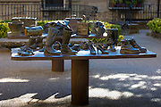 "Bronze table-top sculptures by Koko Rico titled ""Viajeros/Bidaiariak Izenekoa"" at Laguardia in Rioja-Alavesa area of Spain"