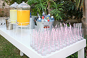 A buffet of pink drinking straws in glasses