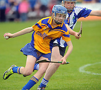Siobhain Kileen St Cillian's (Offaly) chases Aoife Roche Sixmilebridge in the Division 2 Camoige  Final at Pearse Stadium in the Féile na nGael 2011. Photo:Andrew Downes.