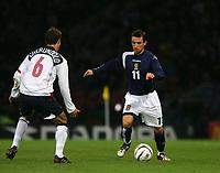 Photo: Andrew Unwin.<br /> Scotland v USA. International Challenge. 12/11/2005.<br /> Scotland's Neil McCann (R) looks to take on the USA's Steve Cherundolo (L).