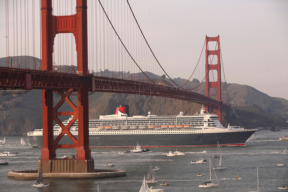 SAN FRANCISCO - FEBRUARY 04: The Queen Mary 2, the largest ocean liner in the world, sails under the Golden Gate Bridge into the San Francisco Bay on February 4, 2007 in San Francisco, California. The Queen Mary 2, a 151,000 ton, 1,132-foot-foot-long ship, is the largest vessel to sail through the Golden Gate and San Francisco Bay and is on an 81-day maiden world cruise. (Photograph by David Paul Morris)