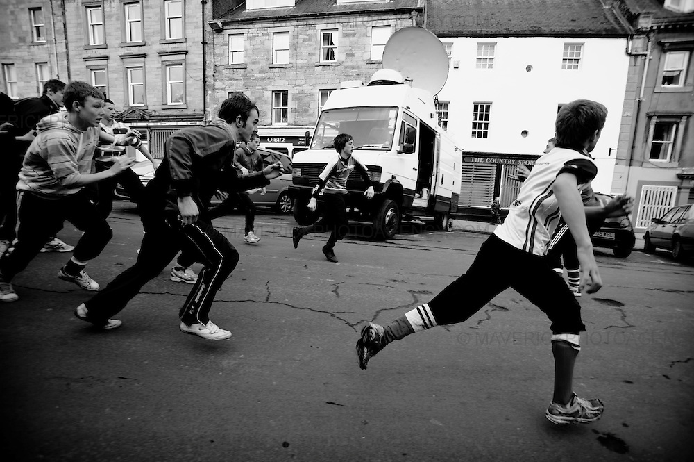 "THE townsfolk of Jedburgh squared up to each other today for the annual Jethard HandBa'.  The traditional ball game, which has been played in the Border town for 250 years, pits the Uppies (residents of the higher part of Jedburgh) against the Doonies (residents from the bottom half of the town).  The game uses a leather ball stuffed with straw and decorated with ribbons. It is then thrown into the group of men which gather together in a scrum and then manhandle it through the streets.  The aim of the game is to ""hail"" the ball to the respective side of the town. For the Uppies it is the castle and for the Doonies it is the Jedwater."