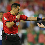 FOXBOROUGH, MASSACHUSETTS - JUNE 10:  Referee Jair Marrufo, USA, points to the penalty spot to give Chile a stoppage time penalty for a hand ball decision during the Chile Vs Bolivia Group D match of the Copa America Centenario USA 2016 Tournament at Gillette Stadium on June 10, 2016 in Foxborough, Massachusetts. (Photo by Tim Clayton/Corbis via Getty Images)