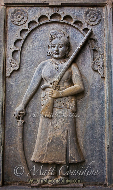 A relief in stone of a sturdy female hunter in a palace in Rajasthan.<br /> (Photo by Matt Considine - Images of Asia Collection)