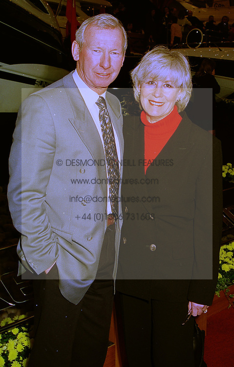 MR & MRS BOB WILSON he is the football commentator, at a reception in London on 14th January 1999.MNE 2