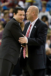 March 27, 2010; Sacramento, CA, USA; Xavier Musketeers head coach Kevin McGuff (left) and Gonzaga Bulldogs head coach Kelley Graves (right) meet before the game in the semifinals of the Sacramental regional in the 2010 NCAA womens basketball tournament at ARCO Arena.  Xavier defeated Gonzaga 74-56.