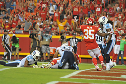 Aug 28, 2015; Kansas City, MO, USA; Kansas City Chiefs tight end Travis Kelce (87) scores a touchdown as Tennessee Titans free safety Michael Griffin (33) attempts the tackle during the first half at Arrowhead Stadium. Mandatory Credit: Denny Medley-USA TODAY Sports